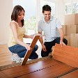 Couple unpacking box in new house